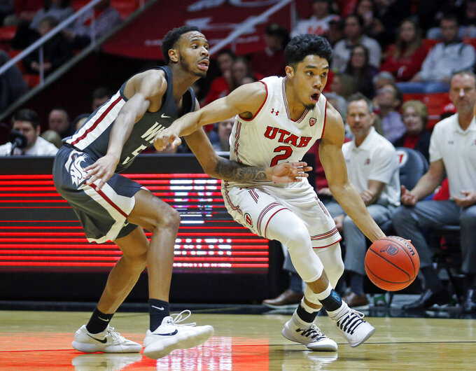 Utah guard Sedrick Barefield (2) drives around Washington State forward Marvin Cannon (5) during the second half of an NCAA college basketball game Saturday, Jan. 12, 2019, in Salt Lake City. (AP Photo/Rick Bowmer)