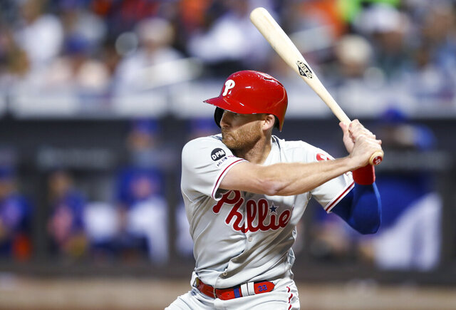 FILE - In this Sept. 7, 2019, file photo, Philadelphia Phillies' Brad Miller bats during the first inning of the team's baseball game against the New York Mets in New York. Miller and the St. Louis Cardinals agreed to a $2 million, one-year contract Wednesday, Feb. 12, 2020, a deal that includes $500,000 in available performance bonuses. (AP Photo/Mary Altaffer, File)