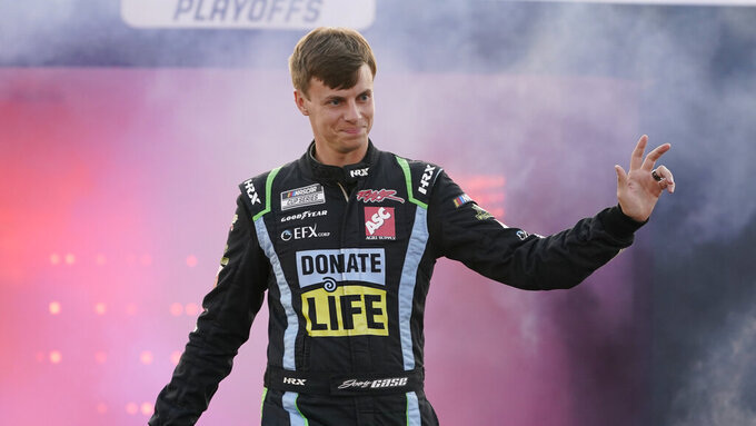 Joey Gase waves to the crowd during driver introductions prior to the start of the NASCAR Cup series auto race in Richmond, Va., Saturday, Sept. 11, 2021. (AP Photo/Steve Helber)