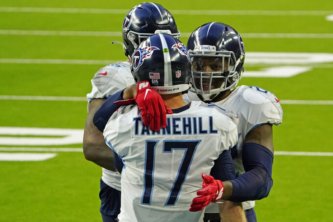Tennessee Titans running back Derrick Henry, right, celebrates with quarterback Ryan Tannehill (17) after running for a touchdown against the Houston Texans during the second half of an NFL football game Sunday, Jan. 3, 2021, in Houston. (AP Photo/Sam Craft)