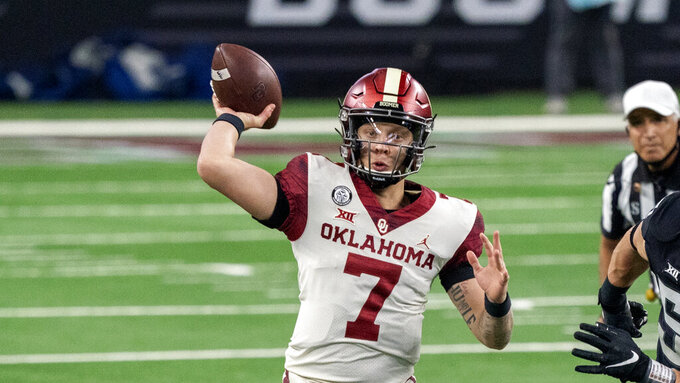 FILE - Oklahoma quarterback Spencer Rattler (7) throws a pass during an NCAA college football game against Iowa State for the Big 12 Conference championship, in Arlington, Texas, in this Saturday, Dec. 19, 2020, file photo. Rattler was selected to The Associated Press Preseason All-America first team offense, Monday Aug. 23, 2021. (AP Photo/Jeffrey McWhorter, File)