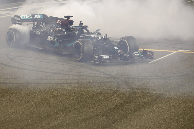 Mercedes driver Lewis Hamilton of Britain burns tires after the Formula One Abu Dhabi Grand Prix in Abu Dhabi, United Arab Emirates, Sunday, Dec. 13, 2020. (Hamad Mohammed, Pool via AP)