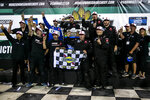 Austin Hill, top center, celebrates with the team after winning the NASCAR Truck Series auto race Friday, July 9, 2021, at Knoxville Raceway in Knoxville, Iowa. (Joseph Cress/Iowa City Press-Citizen via AP)