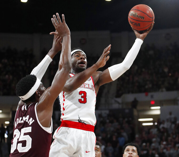 Mississippi guard Terence Davis (3) makes a layup past Mississippi State forward Aric Holman (35) in the second half of an NCAA college basketball game, Saturday, Jan. 12, 2019 in Starkville, Miss. Mississippi won 81-77. (AP Photo/Rogelio V. Solis)
