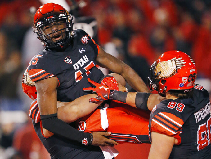 Utah quarterback Jason Shelley (15) is hosted in the air by teammates after scoring against Oregon in the second half during an NCAA college football game Saturday Nov. 10, 2018, in Salt Lake City. (AP Photo/Rick Bowmer)