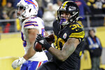 Pittsburgh Steelers running back James Conner (30) scores during the second half of an NFL football game against the Buffalo Bills in Pittsburgh, Sunday, Dec. 15, 2019. (AP Photo/Don Wright)