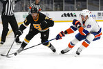 Boston Bruins' Taylor Hall vies for the puck against New York Islanders' Brock Nelson (29) during the first period of an NHL hockey game Friday, April 16, 2021, in Boston. (AP Photo/Winslow Townson)