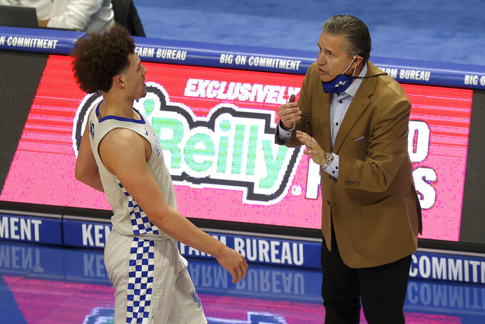 Kentucky coach John Calipari, right, talks to Devin Askew during the second half of the team's NCAA college basketball game against Tennessee in Lexington, Ky., Saturday, Feb. 6, 2021. (AP Photo/James Crisp)