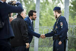 In this handout photo provided by the Hungarian Prime Minister's Press Office shows Hungarian Prime Minister Viktor Orban, left, and Italian Interior Minister Matteo Salvini, second left, during their visit at the Hungarian-Serbian border near Roszke, 180 kms southeast of Budapest, Hungary, Thursday, May 2, 2019. (Balazs Szecsodi/Hungarian Prime Minister's Press Office/MTI via AP)