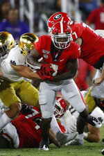 Georgia running back D'Andre Swift (7) moves the ball in the first half of a NCAA football game between Georgia and Notre Dame in Athens, Ga., on Saturday, Sept. 21, 2019. (Joshua L. Jones/Athens Banner-Herald via AP)
