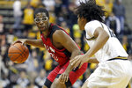 Incarnate Word's Morgan Taylor, left, looks past Missouri's Dru Smith during the first half of an NCAA college basketball game Wednesday, Nov. 6, 2019, in Columbia, Mo. (AP Photo/Jeff Roberson)
