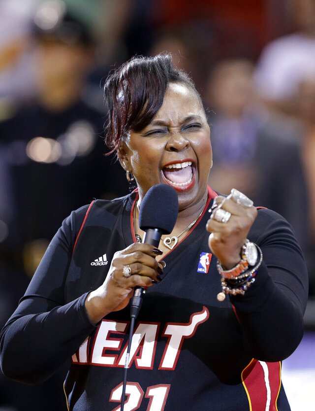 """FILE - In this April 2, 2013, file photo, singer Betty Wright performs the national anthem before an NBA basketball game between the Miami Heat and the New York Knicks in Miami. Wright, the Grammy-winning soul singer and songwriter whose influential 1970s hits included """"Clean Up Woman"""" and """"Where is the Love,"""" has died. Several media outlets reported that Wright died of cancer at her home in Miami on Sunday, May 10, 2020. She was 66. (AP Photo/Wilfredo Lee, File)"""
