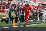 Texas Tech's Myles Price (18) scores a touchdown during the first half of an NCAA college football game against Kansas, Saturday, Dec. 5, 2020, in Lubbock, Texas. (AP Photo/Brad Tollefson)