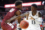 Cincinnati's Tre Scott (13) drives past Alabama A&M's EJ Williams (20) during the first half of an NCAA college basketball game Thursday, Nov. 14, 2019, in Cincinnati. (AP Photo/John Minchillo)