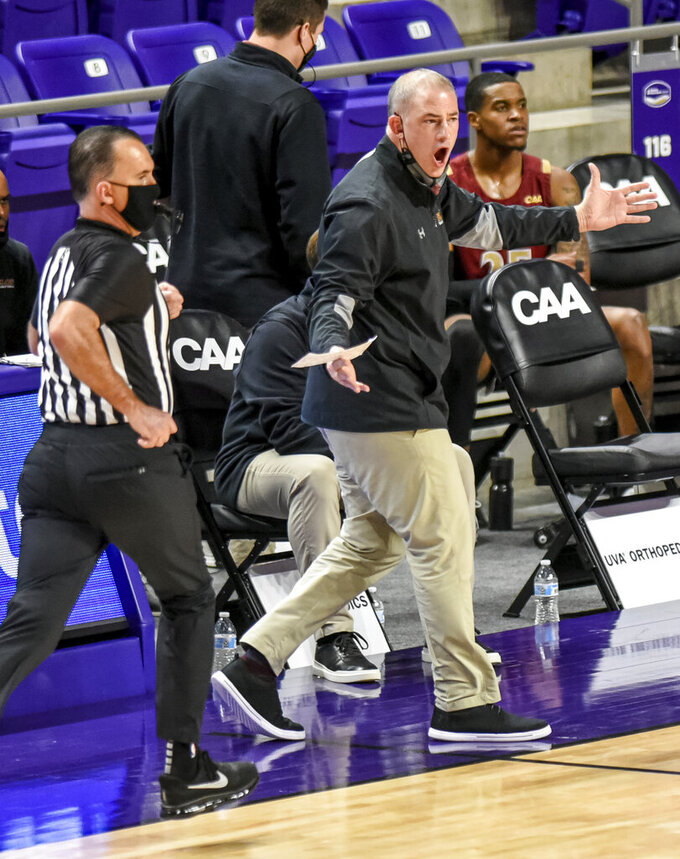 Elon coach Mike Schrage yells to the team during the first half against Drexel in an NCAA college basketball game for the Colonial Athletic Association men's tournament championship in Harrisonburg, Va., Tuesday, March 9, 2021. (AP Photo/Daniel Lin)