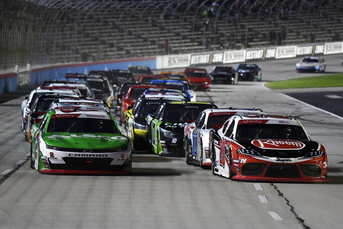Tyler Reddick, left, and Christopher Bell, right, lead the field into Turn 1 during a restart of the NASCAR Xfinity auto race at Texas Motor Speedway in Fort Worth, Texas, Saturday, Nov. 2, 2019. (AP Photo/Larry Papke)