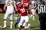 Nebraska linebacker Collin Miller (31) celebrate a tackle of Minnesota quarterback Zack Annexstad (5) during the first half of an NCAA college football game in Lincoln, Neb., Saturday, Oct. 20, 2018. (AP Photo/Nati Harnik)