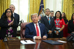 President Donald Trump listens to a question during an event to sign an executive order establishing the Task Force on Missing and Murdered American Indians and Alaska Natives, in the Oval Office of the White House, Tuesday, Nov. 26, 2019, in Washington. (AP Photo/ Evan Vucci)