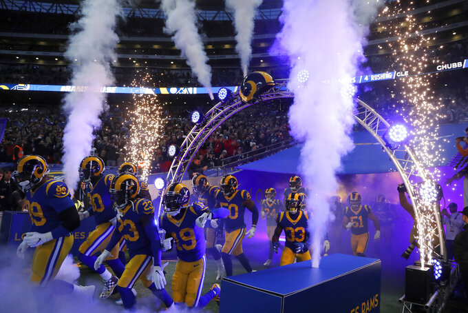 Los Angeles Rams players are introduced before an NFL football game against the Cincinnati Bengals, Sunday, Oct. 27, 2019, at Wembley Stadium in London. (AP Photo/Frank Augstein)