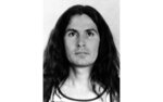 """FILE - In this Wednesday, July 25, 1979, file photo, shows unemployed freelance photographer Rodney James Alcala, 35, has been arrested by the Huntington Beach police for investigation of the murder of a 12-year-old girl on Tuesday, July 24, at his parent's home in Monterey Park, California. Alcala was booked in connection with the killing of Robin Christine Samsoe. Alcala, a prolific serial torture-slayer dubbed """"The Dating Game Killer"""" has died while awaiting execution in California. Rodney James Alcala was 77. He died of natural causes at a hospital in San Joaquin Valley, Calif., prison officials said in a statement. Alcala was sentenced to death in 2010 for five slayings in California between 1977 and 1979, including that of a 12-year-old girl, though authorities estimate he may have killed up to 130 people across the country. (Los Angeles Times via AP, File)"""