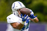 CORRECTS TO ISAIAH KAUFUSI, INSTEAD OF FARROD GREEN - Indianapolis Colts linebacker Isaiah Kaufusi makes a catch during joint practice with the Carolina Panthers at the NFL team's football training camp in Westfield, Ind., Thursday, Aug. 12, 2021. (AP Photo/Michael Conroy)