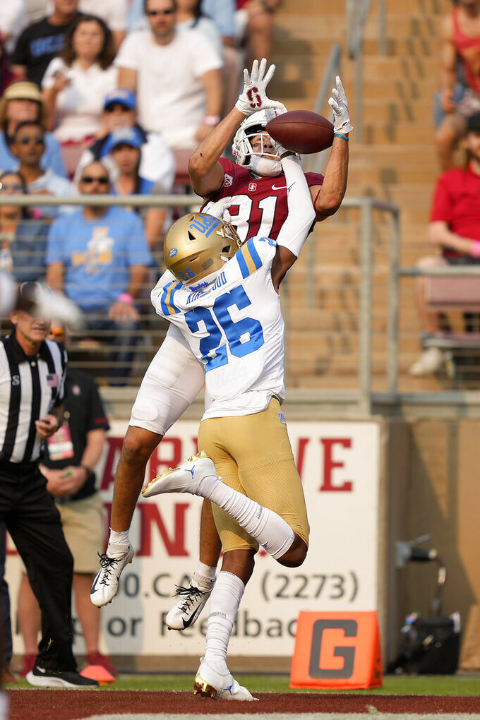 Stanford wide receiver Brycen Tremayne (81) catches a touchdown pass over UCLA defensive back Devin Kirkwood (26) during the first half of an NCAA college football game Saturday, Sept. 25, 2021, in Stanford, Calif. (AP Photo/Tony Avelar)