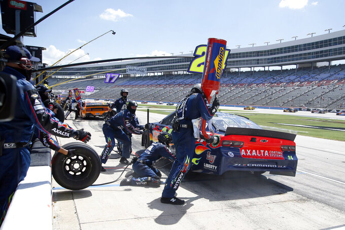 William Byron makes a pit stop during a NASCAR Cup Series auto race at Texas Motor Speedway in Fort Worth, Texas, Sunday, July 19, 2020. (AP Photo/Ray Carlin)