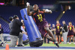 North Carolina State linebacker Germaine Pratt runs a drill at the NFL football scouting combine in Indianapolis, Sunday, March 3, 2019. (AP Photo/Michael Conroy)
