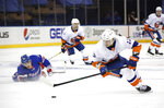 New York Islanders' Mathew Barzal, right, of takes the puck from New York Rangers' Adam Fox, left, during the third period of an NHL hockey game Thursday, Jan. 14, 2021, in New York. (Bruce Bennett/Pool Photo via AP)