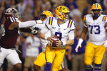 LSU quarterback Joe Burrow (9) looks for a receiver during the first half of the team's NCAA college football game against Texas A&M in Baton Rouge, La., Saturday, Nov. 30, 2019. (AP Photo/Gerald Herbert)