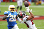 Tampa Bay Buccaneers wide receiver Scott Miller (10) makes a catch after getting past Los Angeles Chargers cornerback Casey Hayward (26) during the second half of an NFL football game Sunday, Oct. 4, 2020, in Tampa, Fla. (AP Photo/Mark LoMoglio)