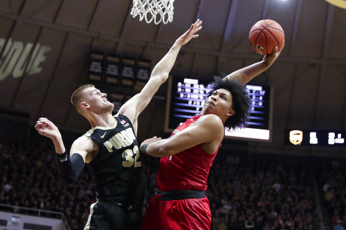 Rutgers guard Ron Harper Jr. (24) goes up for a dunk over Purdue center Matt Haarms (32) during the first half of an NCAA college basketball game in West Lafayette, Ind., Saturday, March 7, 2020. (AP Photo/Michael Conroy)