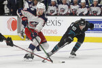 Columbus Blue Jackets center Pierre-Luc Dubois, left, skates against San Jose Sharks left wing Marcus Sorensen (20) during the second period of an NHL hockey game in San Jose, Calif., Thursday, Jan. 9, 2020. (AP Photo/Jeff Chiu)