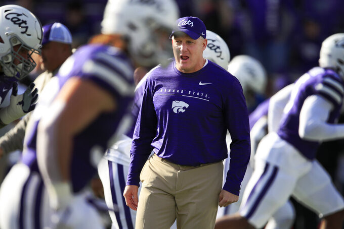 Kansas State head coach Chris Klieman warms up his team before an NCAA college football game against West Virginia in Manhattan, Kan., Saturday, Nov. 16, 2019. (AP Photo/Orlin Wagner)