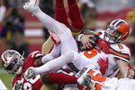 Cleveland Browns quarterback Baker Mayfield (6) is sacked by San Francisco 49ers middle linebacker Kwon Alexander, left, and K'Waun Williams during the first half of an NFL football game in Santa Clara, Calif., Monday, Oct. 7, 2019. (AP Photo/Tony Avelar)