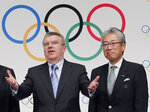 FILE - This Nov. 20, 2013, file photo shows Japan Olympic Committee President Tsunekazu Takeda, right, and  International Olympic Committee (IOC) President Thomas Bach, left, following a press conference in Tokyo. France's financial crimes office says International Olympic Committee member Takeda is being investigated for corruption related to the 2020 Tokyo Olympics. The National Financial Prosecutors office says Takeda, the president of the Japanese Olympic Committee, was placed under formal investigation for