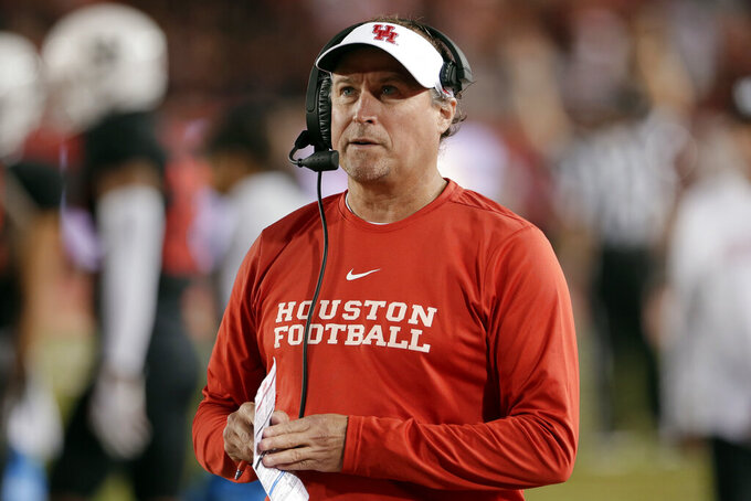 FILE - In this Oct. 24, 2019, file photo, Houston coach Dana Holgorsen watches during the second half of the team's NCAA college football game against SMU in Houston. Holgorsen, in his second year at Houston, and the Cougars face Baylor this week, in the first meeting between the schools since 1995. (AP Photo/Michael Wyke, File)