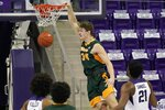 North Dakota State forward Rocky Kreuser (34) dunks as TCU's PJ Fuller, bottom left, and Kevin Samuel (21) watch during the second half of an NCAA college basketball game in Fort Worth, Texas, Tuesday, Dec. 22, 2020. (AP Photo/Tony Gutierrez)