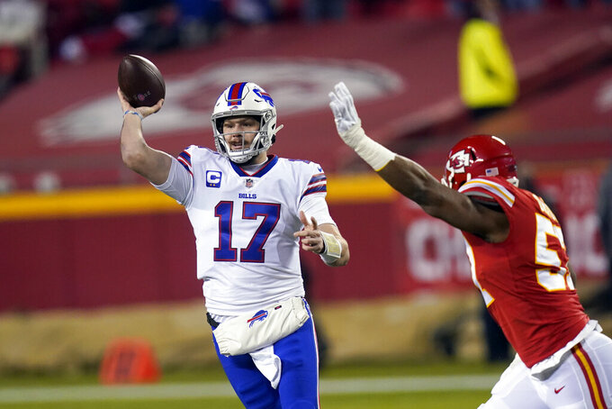 Buffalo Bills quarterback Josh Allen (17) throws a pass ahead of Kansas City Chiefs defensive end Mike Danna, right, during the first half of the AFC championship NFL football game, Sunday, Jan. 24, 2021, in Kansas City, Mo. (AP Photo/Orlin Wagner)
