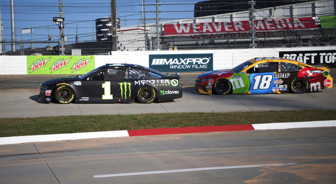 Kurt Busch (1) maintains a small lead against his younger brother Kyle Busch (18) during a NASCAR Cup Series auto race at the Martinsville Speedway in Martinsville, Va., Sunday, Nov. 1, 2020. (AP Photo/Lee Luther Jr.)