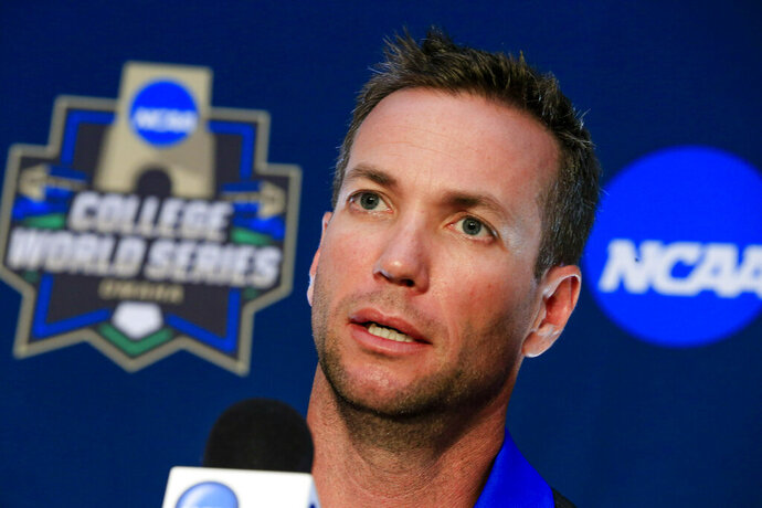 FILE - In this June 17, 2016, file photo, UC Santa Barbara NCAA college baseball coach Andrew Checketts speaks during a coaches' news conference at TD Ameritrade Park in Omaha, Neb., ahead of the College World Series. UC Santa Barbara, which had two straight losing seasons after reaching the College World Series in 2016, has won nine straight after sweeping nationally ranked UC Irvine. The Gauchos are 27-5 overall, 5-1 in the Big West and ranked in the top 10 this week.(AP Photo/Nati Harnik, File)