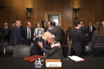 Eugene Scalia hugs his wife Patricia during a break in his nomination hearing for Labor Secretary before the Senate Committee on Health, Education Labor and Pensions on Capitol Hill, in Washington, Thursday, Sept. 19, 2019. (AP Photo/Cliff Owen)