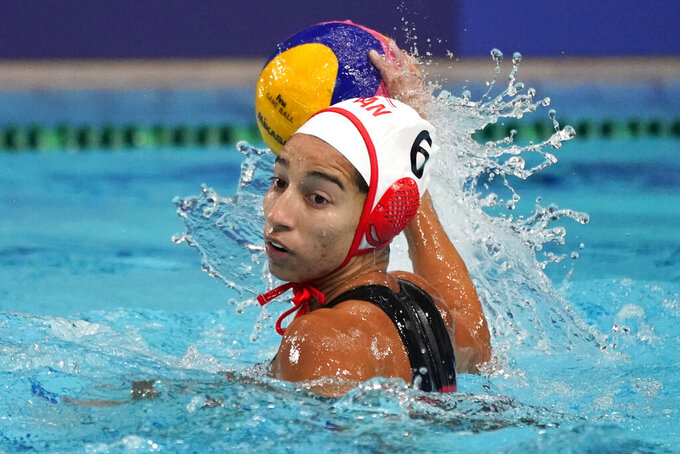 CORRECTS TO CANADA'S GURPREET SOHI PLAYING AGAINST SOUTH AFRICA  - Canada's Gurpreet Sohi plays against South Africa during a preliminary round women's water polo match at the 2020 Summer Olympics, Wednesday, July 28, 2021, in Tokyo, Japan. (AP Photo/Mark Humphrey)