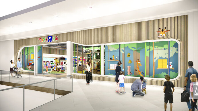 """This undated artist rendering provided by Toys""""R""""Us shows an artist rendering of a new store, which will be about 6,500 square feet — a fraction of the brand's former big box stores, which were about 30,000 square feet. Richard Barry, a former Toys R Us executive and now CEO of the new company called Tru Kids Brands, said the company has entered a partnership with a startup called b8Ta, an experiential retailer to launch what Barry calls an interactive store experience based on a consignment model. Toy makers will pay for space in the stores but will get all the sales. (Courtesy of Toys""""R""""Us via AP)"""