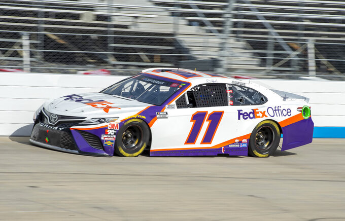 Denny Hamlin (11) leads during a NASCAR Cup Series auto race at Dover International Speedway, Saturday, Aug. 22, 2020, in Dover, Del. (AP Photo/Jason Minto)
