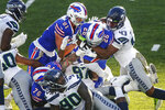 Seattle Seahawks Carlos Dunlap (43) tackles Buffalo Bills' Devin Singletary (26) during the second half of an NFL football game Sunday, Nov. 8, 2020, in Orchard Park, N.Y. (AP Photo/John Munson)