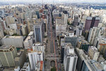 An aerial view of the almost empty Paulista Avenue, one of the city's most important financial center, on the first day of quarantine to help stop the spread of the new coronavirus in Sao Paulo, Brazil, Tuesday, March 24, 2020. (AP Photo/Andre Penner)