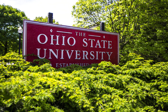 FILE - This May 8, 2019, file photo, shows a sign for Ohio State University in Columbus, Ohio. Ohio State University said Tuesday, Oct. 13, 2020, it will pay $5.8 million to settle lawsuits by about two dozen more survivors over decades-old sexual abuse by a now-deceased team doctor, Richard Strauss. (AP Photo/Angie Wang, File)
