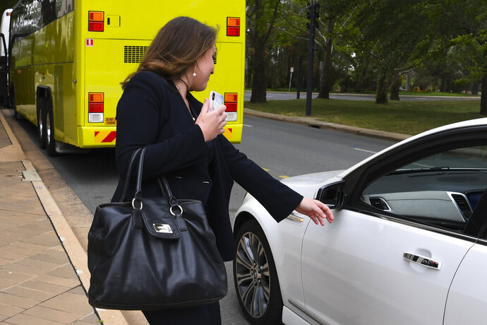 News Corp. journalist Annika Smethurst gets on a car while leaving the High Court of Australia in Canberra, Australia, Tuesday, Nov. 12, 2019. She went to Australia's highest court to overturn a search warrant that created outrage when it was executed on her home and triggered a national campaign for greater press freedom. (Lukas Coch/AAP Images)