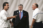 FILE — In this Aug. 3, 2004, file photo, Tennessee Titans had coach Jeff Fisher, left, and general manager Floyd Reese, right, talk with owner Bud Adams, center, during an NFL football practice in Nashville, Tenn. The Titans announced July 14, 2021, that Fisher, Reese, and former Houston Oiler head coach Bum Phillips will be the newest members of the Tennessee Titans' ring of honor. (AP Photo/Mark Humphrey, File)
